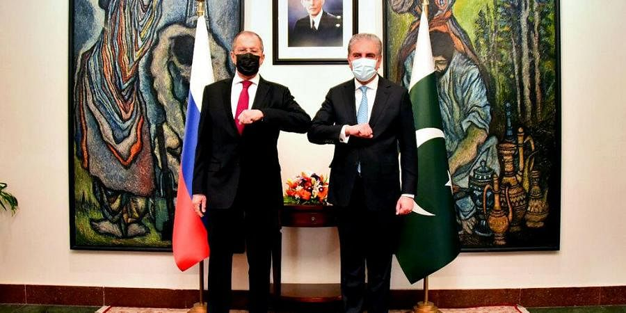 Pakistan's Ministry of Foreign Affairs, Russia's Foreign Minister Sergey Lavrov, left, bumps elbows with his Pakistani counterpart Shah Mahmood Qureshi