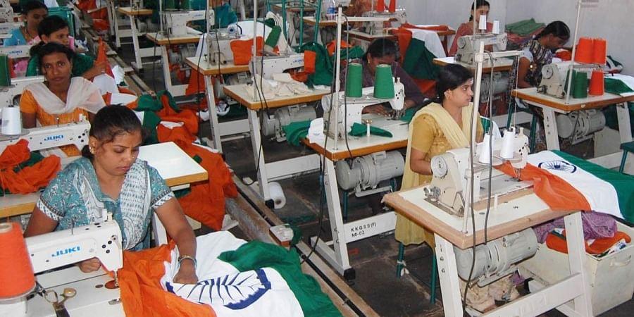 Women workers make national flags at the Bengeri khadi unit in Hubballi. (Photo | D Hemanth, EPS)