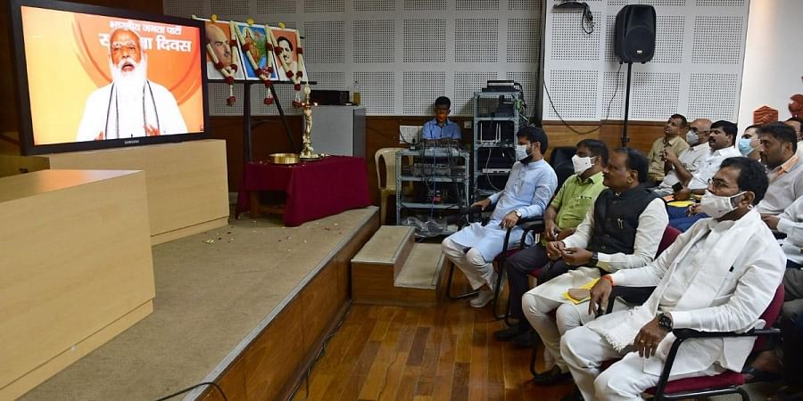 BJP national general secretary C T Ravi and party workers watch PM Narendra Modi speak on the party's Foundation Day, in Bengaluru on Tuesday | Ashishkrishna HP