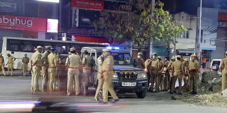 Police personnel deployed at Velachery-Taramani road after two people were grilled by the public for carrying EVMs | Ashwin Prasath
