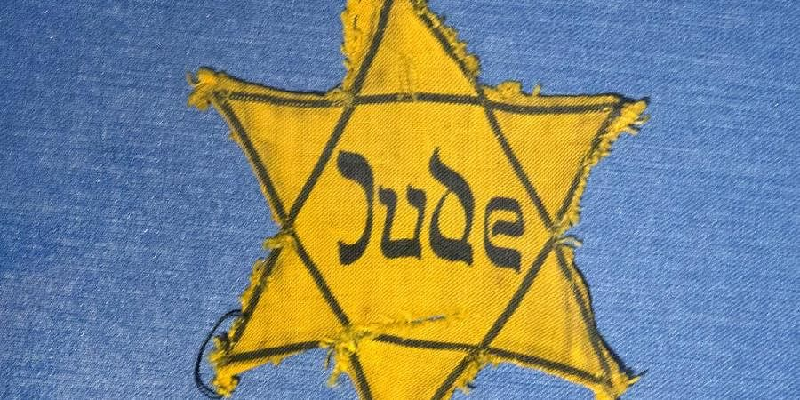 The Yellow Star badge of Heinz-Joachim Aris (Dresden 1941) reading 'Jew' is displayed in a showcase. (Photo   AP)