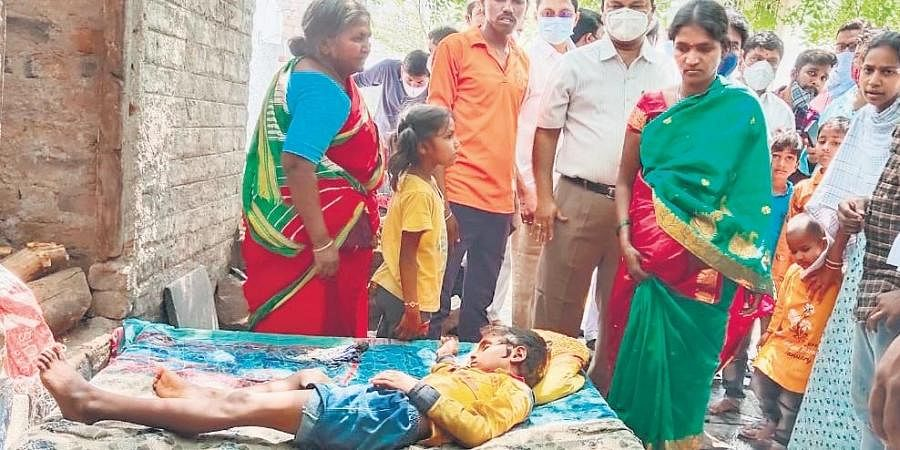 People who fell ill due to consumption of contaminated water at Arun Jyothi Nagar in Adoni on Wednesday | Express