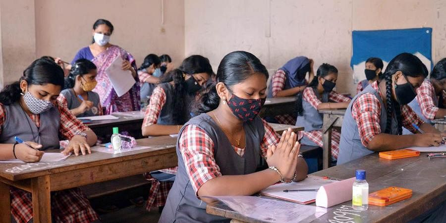Students appearing for the exams at Government Model Higher Secondary School for Girls, Pattom,  Thiruvananthapuram. (Photo   Vincent Pulickal, EPS)