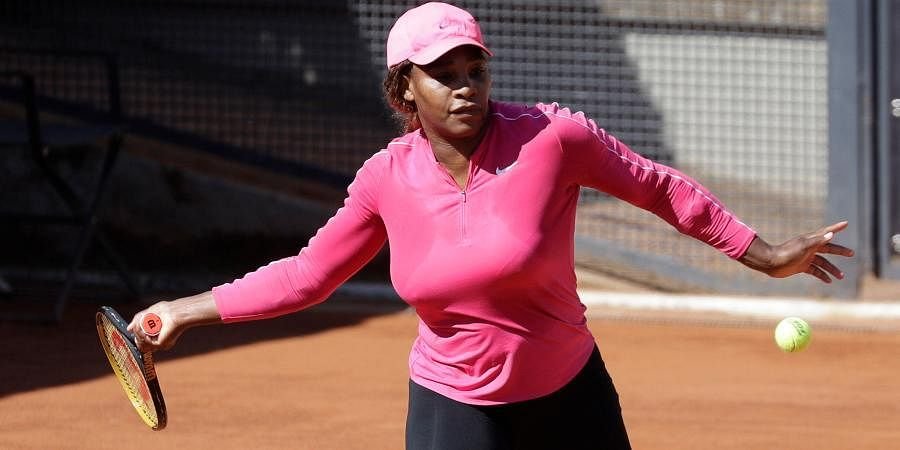 Serena Williams returns the ball during a training session at the Italian Open tennis tournament.
