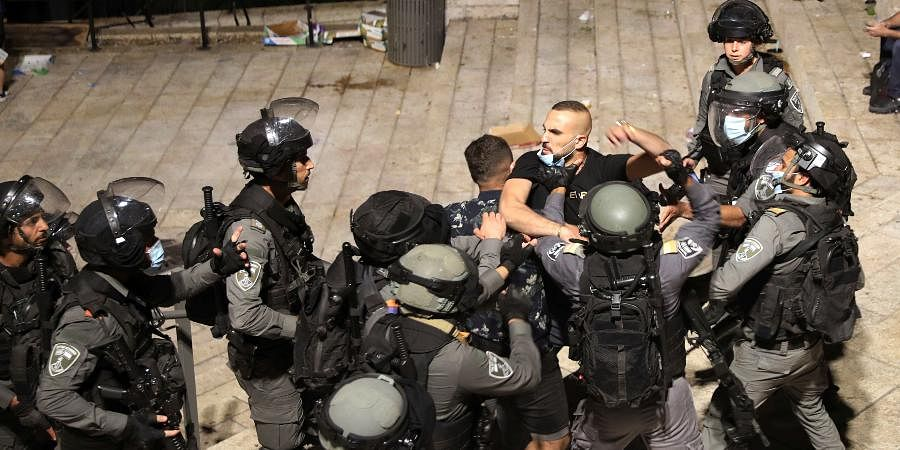 Israeli police forcibly detain a Palestinian outside of the Damascus Gate to the Old City of Jerusalem.