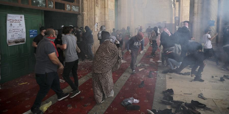 Palestinians clash with Israeli security forces at the Al Aqsa Mosque compound in Jerusalem's Old City.