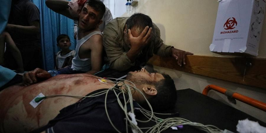 Mourners react in a hospital over the body of a man who died following an explosion in the town of Beit Lahiya, northern Gaza Strip.