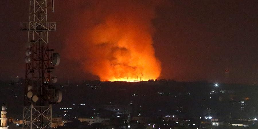 Fire burns and smoke rises after an Israeli forces strike in the Gaza Strip.