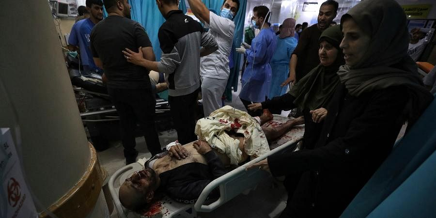 Medics treat wounded accompanied by their relatives in a hospital following an explosion in the town of Beit Lahiya, northern Gaza Strip.