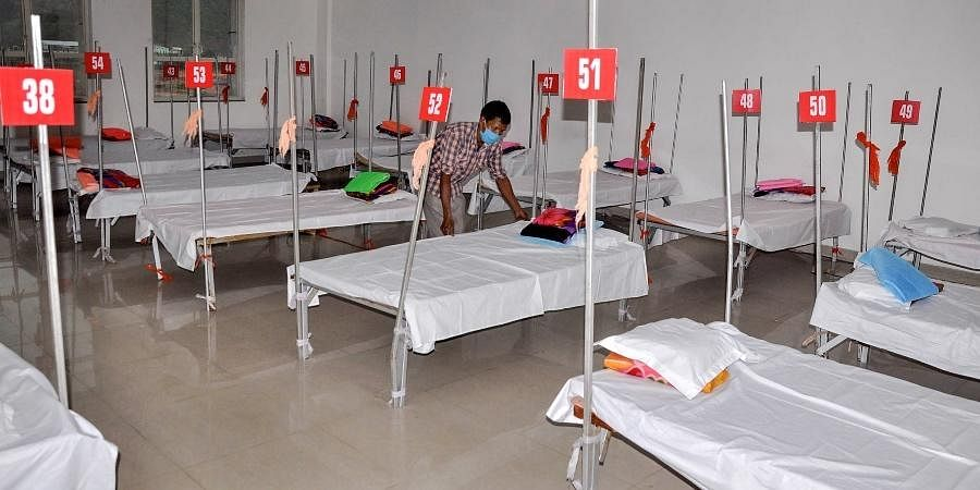 Workers prepare a 1000 bed Covid Care Centre at Royal Global University premises in Guwahati