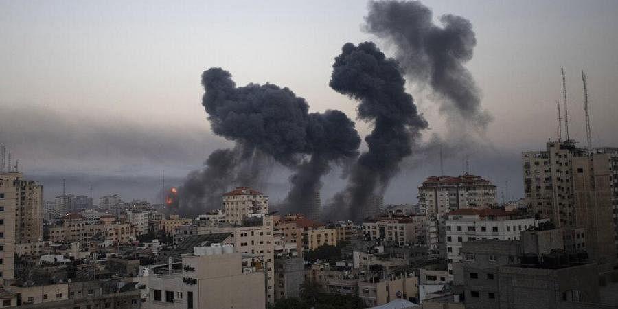 Smoke rises after Israeli airstrikes on Gaza City