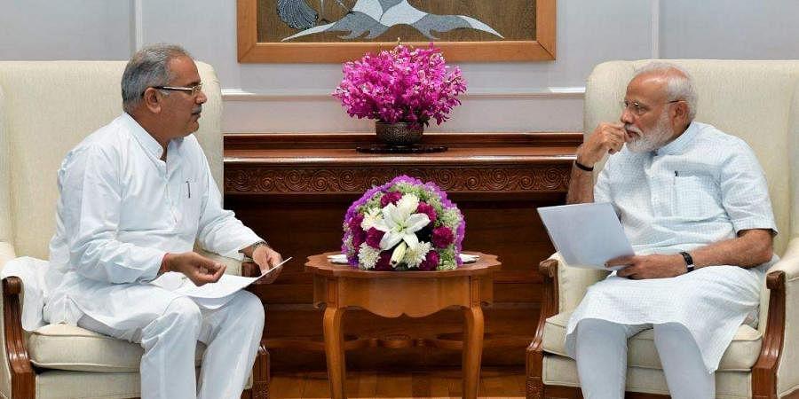 Chief Minister of Chhattisgarh Bhupesh Baghel meets PM Narendra Modi at the latter's office