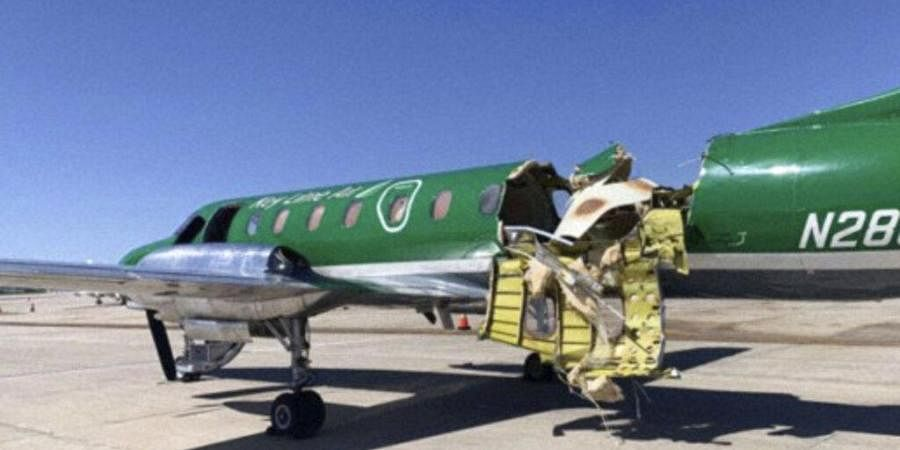 This image from CBS Denver shows a Key Lime Air Metroliner that landed safely at Centennial Airport after a mid-air collision near Denver