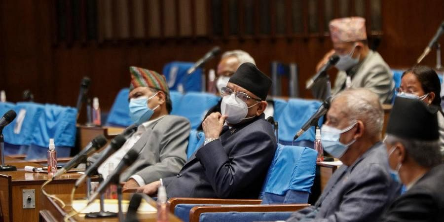 Pushpa Kamal Dahal, leader of the splinter group in the governing Nepal Communist Party attends a meeting of the parliament in Kathmandu