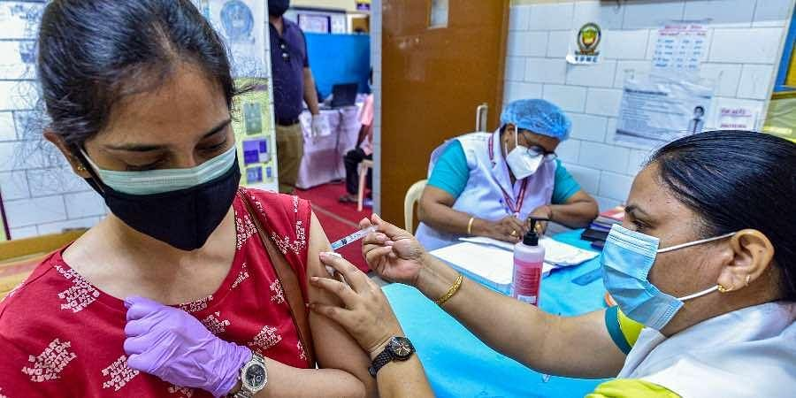 A medic administers COVID-19 vaccine to a beneficiary amid the second wave of coronavirus epidemic, in New Delhi