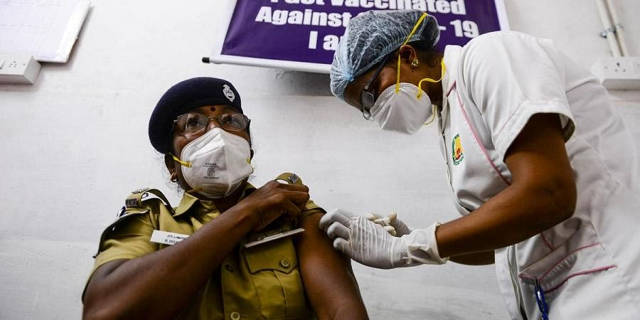 A health worker administers vaccine for COVID-19 at a vaccination center in Chennai. (Photo   Debadatta Mallick, EPS)