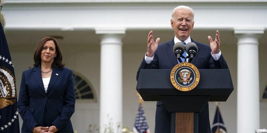 Vice President Kamala Harris listens as President Joe Biden speaks on updated guidance on mask mandates, in the Rose Garden of the White House.