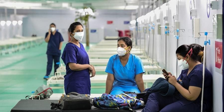 Health workers wait for their duty schedule, at the 500 ICU beds service for COVID-19 patients at Ramlila Maidan opposite GTB hospital in New Delhi,