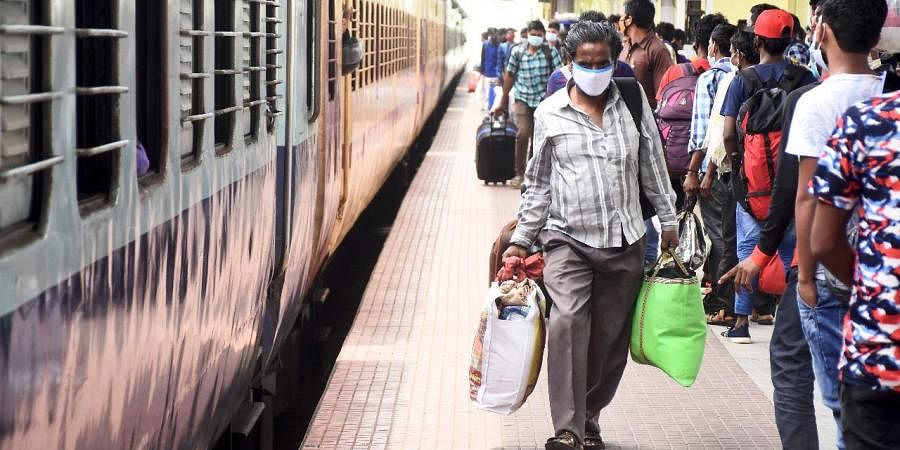 Fearing more Covid-19 restrictions, migrant workers leaving for their hometowns await trains at the Coimbatore railway station on Tuesday.