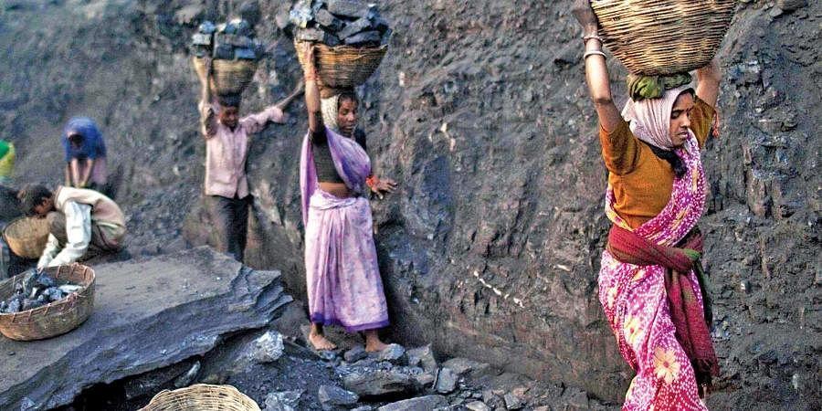 Tribals working in a coal mine