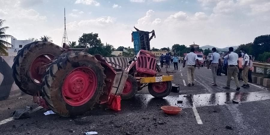 Mangled remains of the tractor which was hit by a speeding truck near Don Bosco school on Pune-Bengaluru national highway in Chitradurga on Friday.