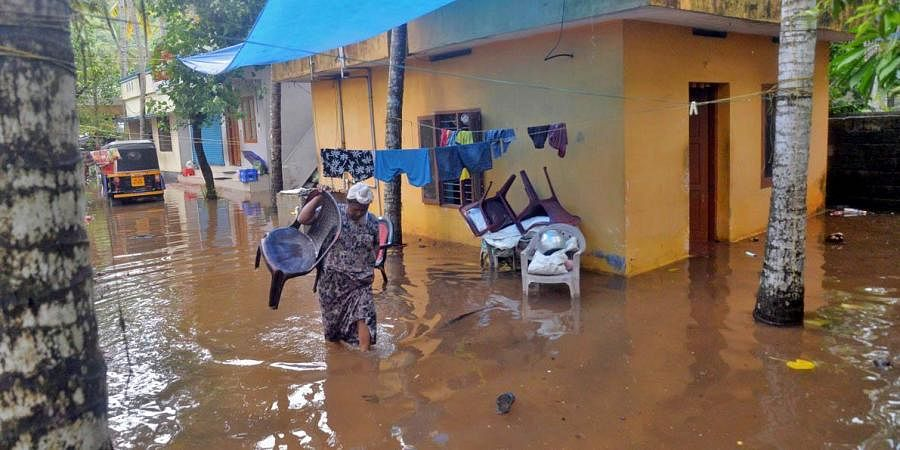 People wade through inundated waters in Thiruvananthapuram. (Photo   Vincent Pulickal, EPS)