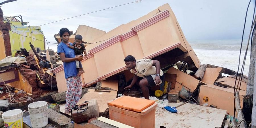 A man searches for his belongings amid debris of his house at Kochuthope coastal village in Thiruvananthapuram following sea erosion. (Photo| Vincent Pulickal, EPS)