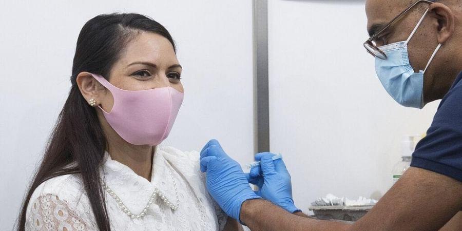 Britain's Home Secretary Priti Patel receives her first dose of the Moderna Covid-19 vaccine.