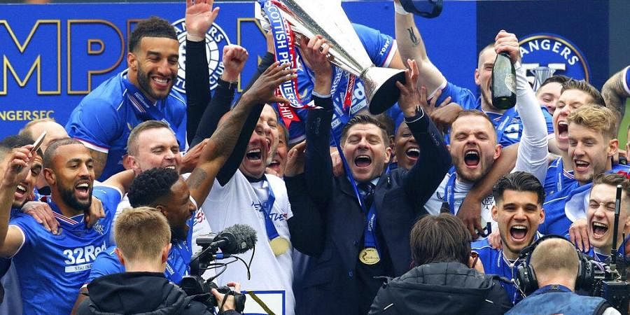 Rangers manager Steven Gerrard and the team celebrate winning the Scottish Premiership after the match against Aberdeen