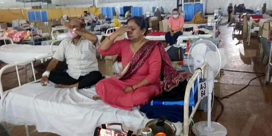 COVID19 patients take part in yoga and meditation sessions at Sardar Patel COVID Care Centre in New Delhi
