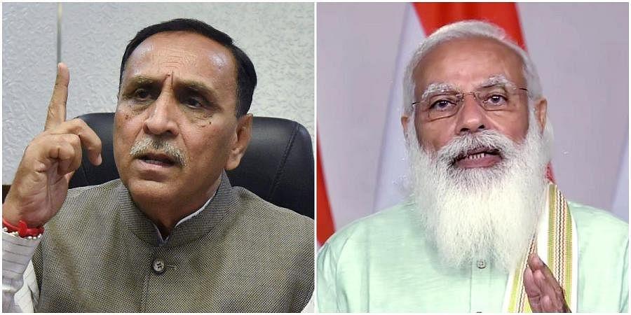 Gujarat CM Vijay Rupani (L) and PM Narendra Modi