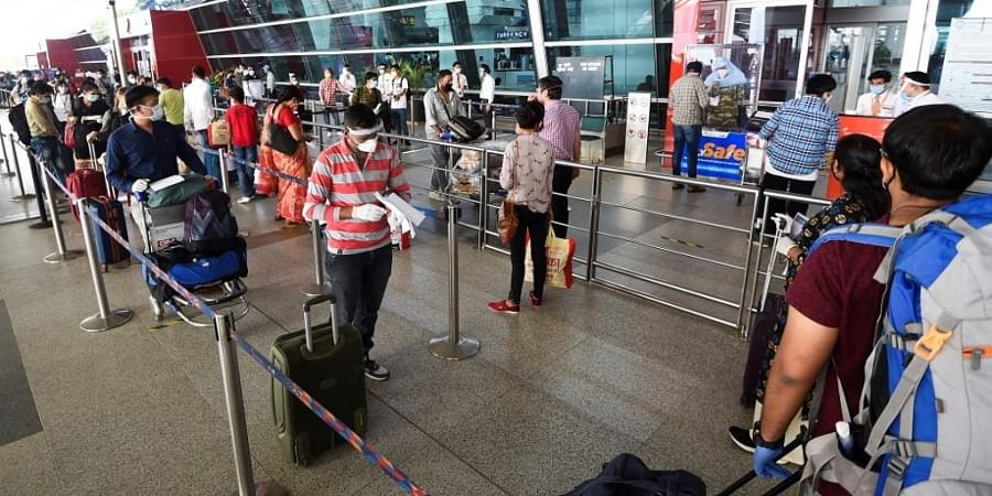 Passengers lineup to check-in outside the Indira Gandhi International airport. (Photo   AFP)