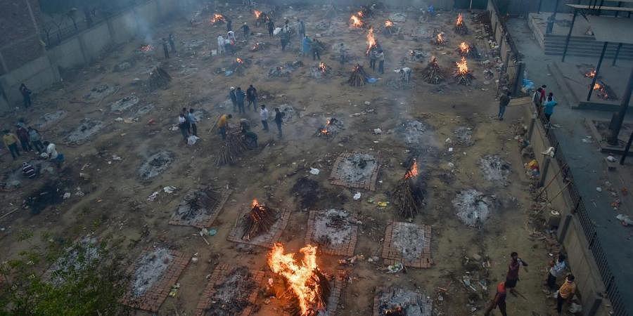 Mass cremation of COVID-19 victims at Old Seemapuri Crematorium as coronavirus cases surge in New Delhi, Friday, April 23, 2021.