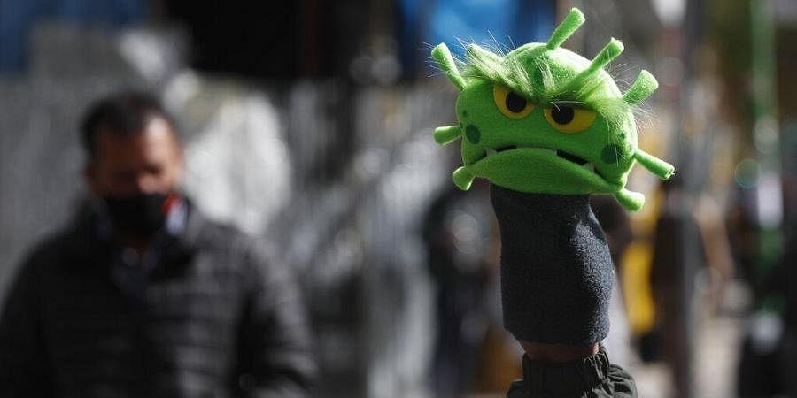 A street vendor sells new coronavirus puppets in La Paz, Bolivia, Thursday, July 9, 2020.