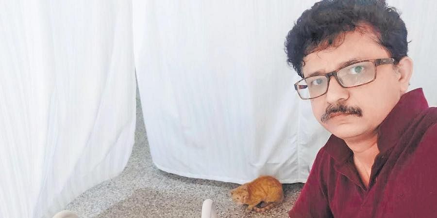 The COVID ward Ahmad Azeem was admitted to had cats; this orange one even climbed his food table.