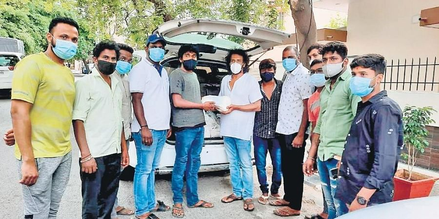Actor Upendra distributes Covid relief material