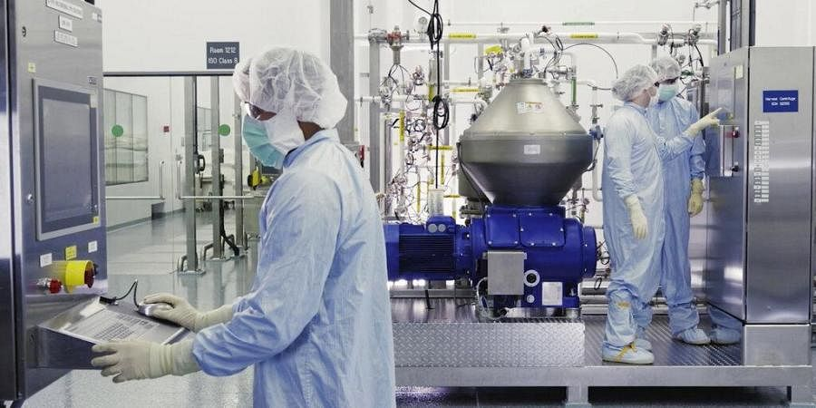 Scientists work with a bioreactor at a Regeneron Pharmaceuticalsfacility in New York state, for efforts on an experimental coronavirus antibody drug.