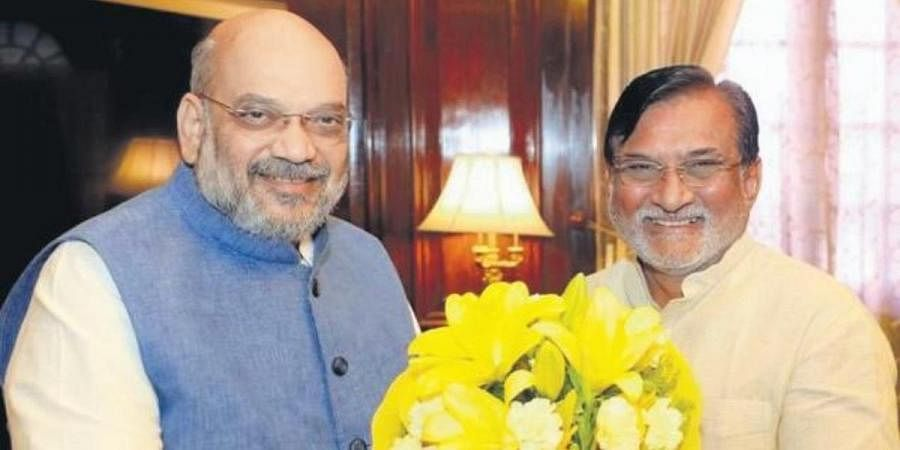 Union minister Amit Shah (L) and Lakshadweep administrator Praful Patel
