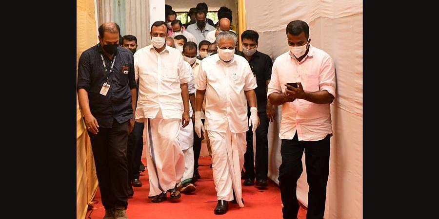Chief Minister Pinarayi Vijayan walks into Pinarayi Convention Centre to address the media on Sunday evening. (Photo | EPS)