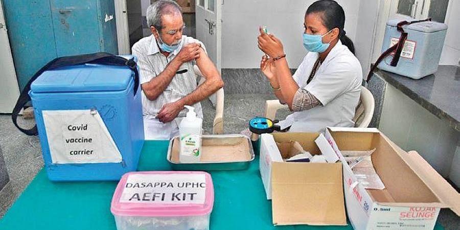 A senior citizen gets a Covid vaccine shot in Bengaluru. (Photo | Express)