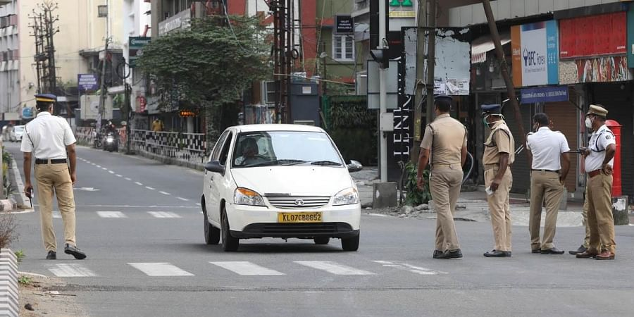 Police checking at MG road on Sunday as part of the  the weekend restrictions similar to lockdown. (Photo | Arun Angela, EPS)