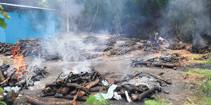 Pyres of Covid and suspected Covid victims burn endlessly at the ESI cremation ground, where around 30 to 40 bodies are being cremated on a daily basis (Photo | S Senbagapandiyan, EPS)