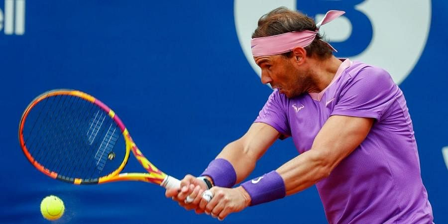 Rafael Nadal of Spain returns the ball to Ilya Ivashka of Belarus during the Godo tennis tournament in Barcelona