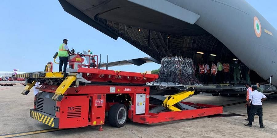 Officials unload COVID-19 relief material brought to Chennai by the Air Force from the United Kingdom in a long-haul flight.