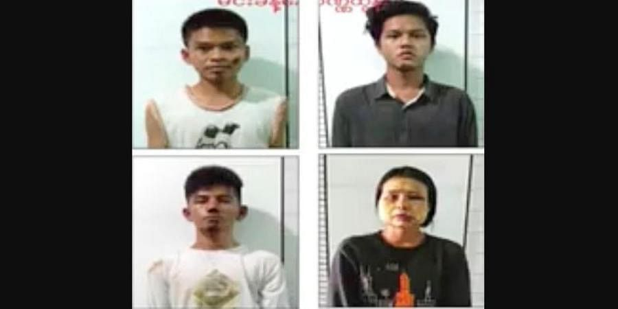 This image from an news report by Myawaddy TV shows people who security forces said they detained in a weapons raid a day earlier in the Yankin township of Yangon, Myanmar.