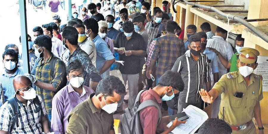 People waiting in a long queue to get Remdesivir at Kilpauk Medical College Hospital in Chennai