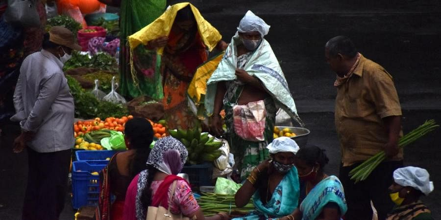 People take cover from the rains in Hyderabad
