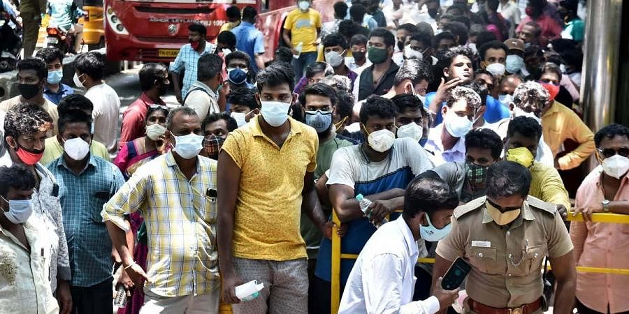 Relatives of Covid patients wait in a long queue to avail Remedesivir at Government Kilpauk Medical College in Chennai. (Photo | P Jawahar, EPS)