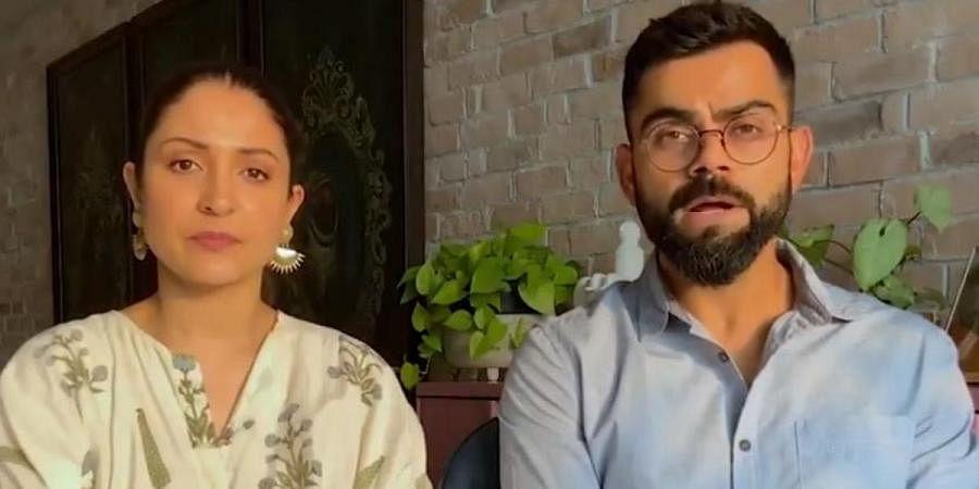 Indian cricketer Virat Kohli (L) and wife Anushka Sharma