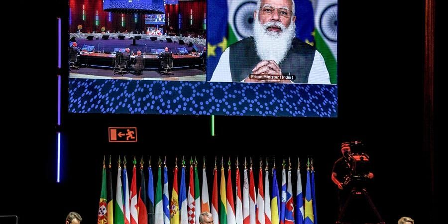 PM Modi in a virtual meeting with EU officials.